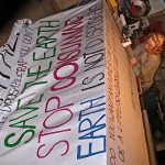 lauren Renzetti painting a G20 sign in 2010