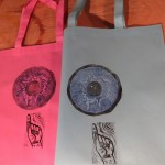 Look Up , hand stamped on bags, $5 by Lauren McKinley Renzetti
